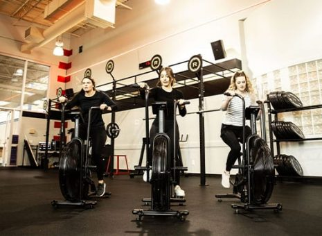 gym members cycling during a workout
