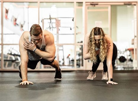 trainer and client working out